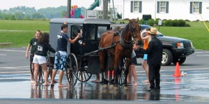 Amish buggy being washed by kids